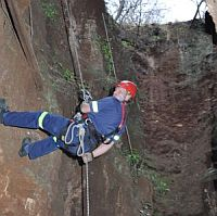 Person abseiling into Crystal Cave